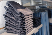 A Stack Of New Jeans On A Store Shelf In The Portuguese City Of Porto