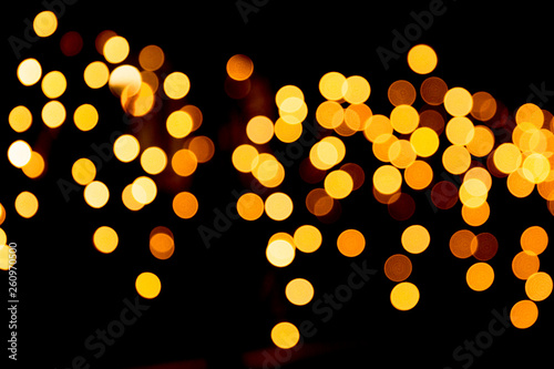 Fototapeta Festive abstract gold background with bokeh defocused and blurred many round yellow light on Christmas dark background obraz na płótnie