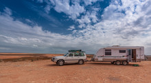 Four Wheel Drive Vehicle And Large Caravan At Roadside Stop In The Outback Of Australia.