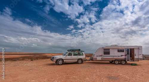 Fotografia, Obraz Four wheel drive vehicle and large caravan at roadside stop in the outback of Australia