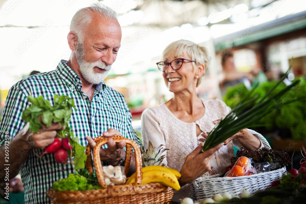 Fototapety, obrazy: Shopping, food, sale, consumerism and people concept - happy senior couple buying fresh food