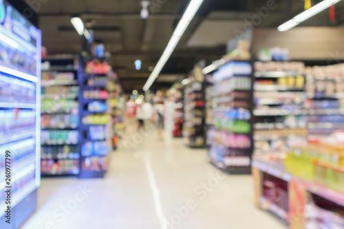 supermarket aisle with product shelves interior defocused blur background