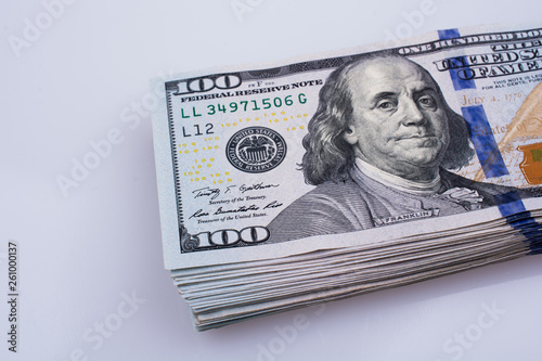 Fotografía  American 100 dollar banknotes placed on white background