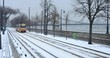 Old yellow Tram and chain bridge at winter