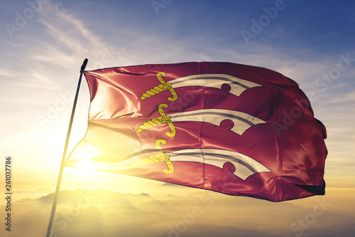 Photo Essex county of England flag waving on the top sunrise mist fog