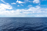 Atlantic Ocean Seascape with blue ocean and a sky filled with clouds
