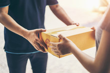 Delivery Man Delivering Holding Parcel Box To Customer