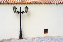 Street Electric Lamp Post At White Wall