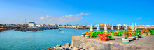 Landscape With Colorful Street Cafe On Quay Of Fishing Port At Essaouira. Morocco, North Africa