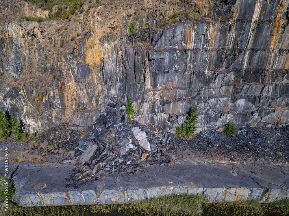 Fotografie, Tablou  Slate mine with rockfall, top view of the wall