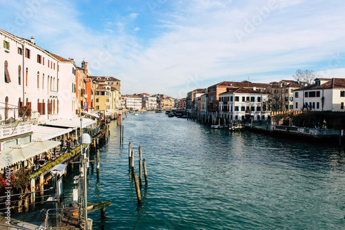 Grand Canal in Venice on a sunny day, Italy. Venice in the sunlight. Scenic panoramic view of Venice in winter. Cityscape and landscape of Venice. Romantic water trip.