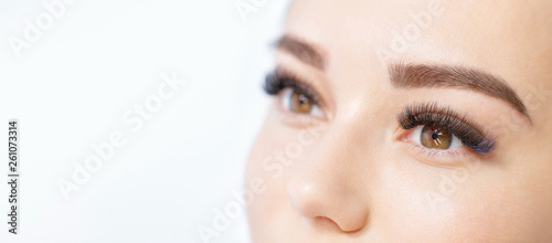 Fotografering  Close up view of beautiful brown female eye with long eyelashes, smooth healthy skin