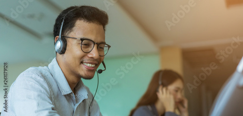 Stampa su Tela close up asian man call center agent wear headset device and smiling working in