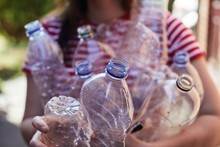 Woman Recycling Plastic