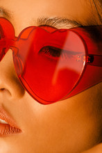 Close Up Of Woman In Heart Shape Glasses