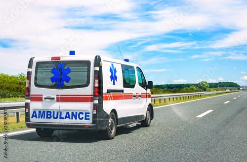Ambulance van on road Canvas Print