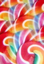 Close-up Of Swirly Rainbow Lollipop Through Prism Filter