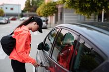 Sportswoman Unlocking Car On S...