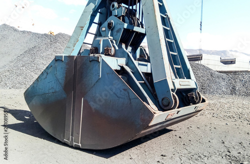 Photo  Clamshell bucket in the cargo port. Bucket for loading coal