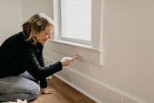 Middle Aged Woman Painting Home