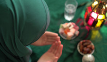 Muslim Woman Wearing Hijab. Holy Month Of Ramadan. Dua (prayer) For Breaking Fast And Beginning Fast. Food And Water. Praying, Islam, Religion