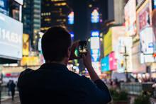 Man Taking Photo At Times Square