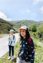 Group Of Little Girls Hiking O...