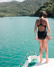 Teen Climbing Onto A Boat In The Gorges Du Verdon