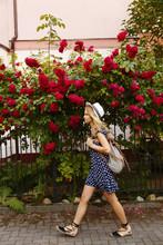 Casual Woman Walking At Bushes