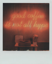 Polaroid With Vinyl Records And Glowing Inscription
