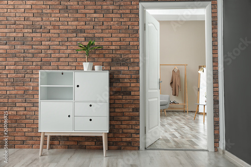 Room interior with stylish white cabinet and open door Wallpaper Mural