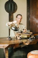 Man Conducting Oriental Traditional Tea Ceremony