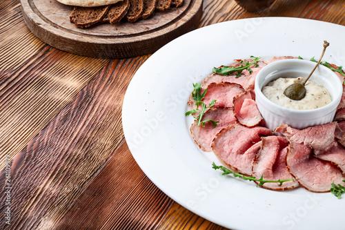 Carta da parati Close up view on traditional italian cuisine Vitello tonnato