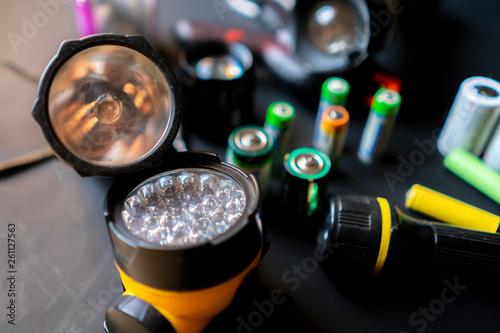 Obraz persons hands hold a flashlight in a workshop b - fototapety do salonu