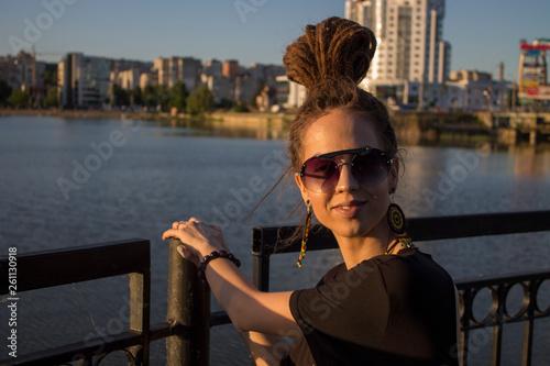 dreadlock girl with dreads and rastaman earrings Canvas Print