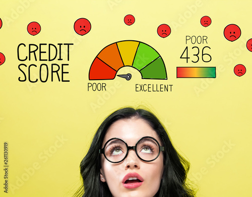 Poor credit score theme with young woman wearing eye glasses Fototapeta