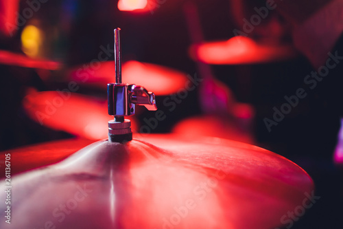 Warm toned live music photo background, drummer plays on rock drum set. Close-up photo, soft selective focus. - 261136705