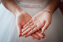 Bride Holding Gold Christian C...