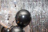 Foil balloons on the background against a shiny wall.