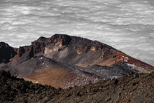 Aerial View Of Crater Over The Cloudy Sky