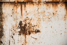 Rusty Metal Textured Background With Chipped White Paint. Old Rough Rusted Grungy Surface