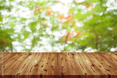 Fotografía  Emtry wooden table on top over blur natural background, can be used mock up for montage products display or design layout