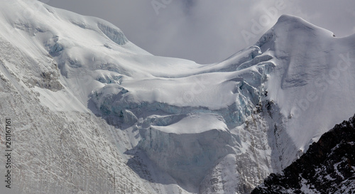 Fototapeta Snow Mountain, Massive Glacier, Wall of Ice, Mountain Cliff Face covered in ice,