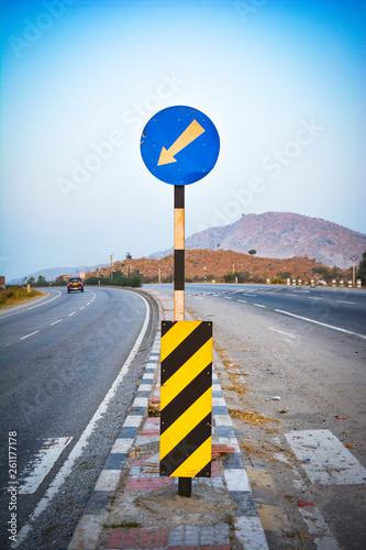 Photo Blue, circular left turn traffic sign