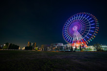 Ferris Wheel At Night In The Amusement Park