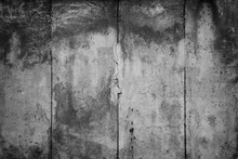 Close-up Of A Weathered And Aged Concrete Wall With Vignette In Black And White. Full Frame Texture Background Of The Original Berlin Wall.