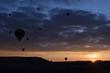 Sunrise and balloons. Beautiful background of the balloon and the sunset.Cappadocia. Turkey. Göreme. Nevşehir. Türkiye. 8. 04. 2019. Balloons flying over the rocky landscape in Cappadocia Turkey. View