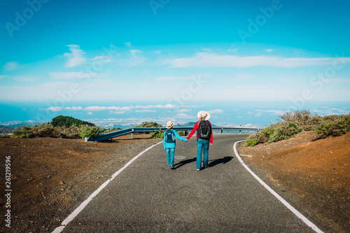 Fotografia, Obraz family travel- mother and son walking on road in mountains