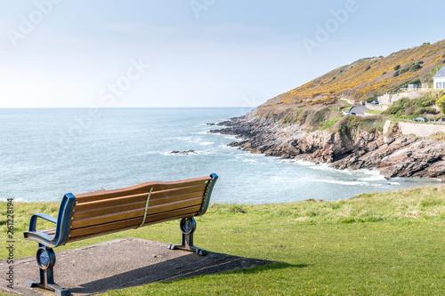 Fotografía  Empty bench on the mumbles coastline, Wales