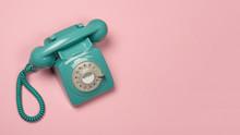 Blue Vintage Phone On A Pink B...